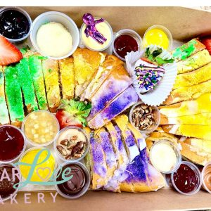 Charcuterie King Cake Board by Sugar Love Bakery